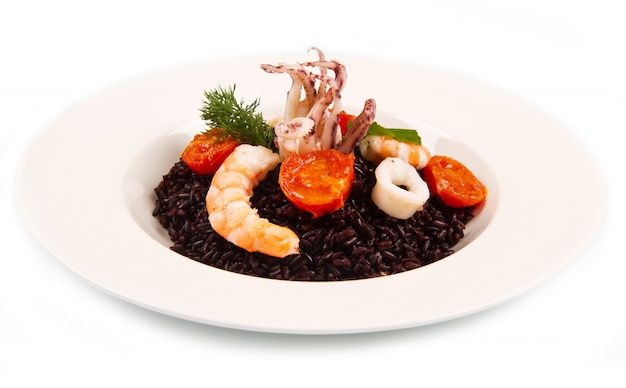 Black rice with squid , prawns and tomatoes