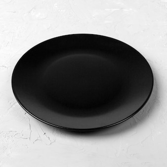 Black round plate on wooden