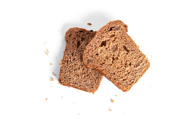 Black, rye bread with dried fruit on a white background. high quality photo