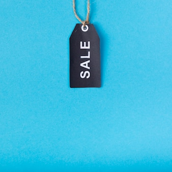 Black sale tag hanging from above