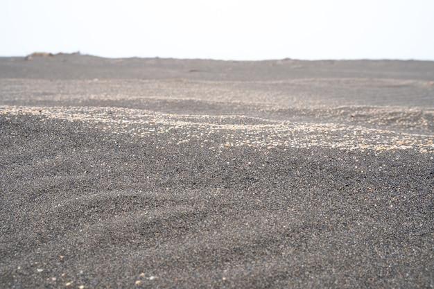 Black sand on the black sea coast in the city of poti, georgia