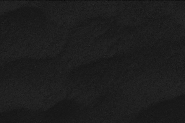 Black sand texture. wallpaper and black friday concept.