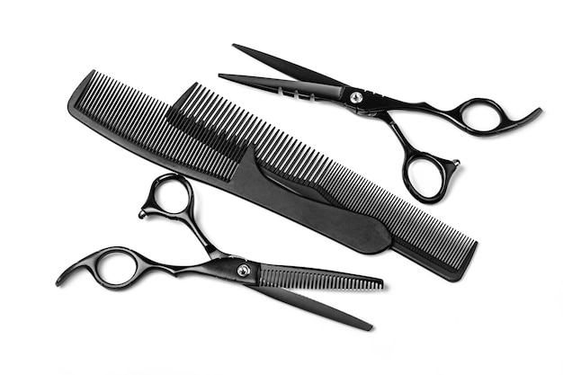 Black scissors iand comb isolated on white background