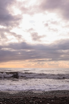 Black sea waves and cloudy sky
