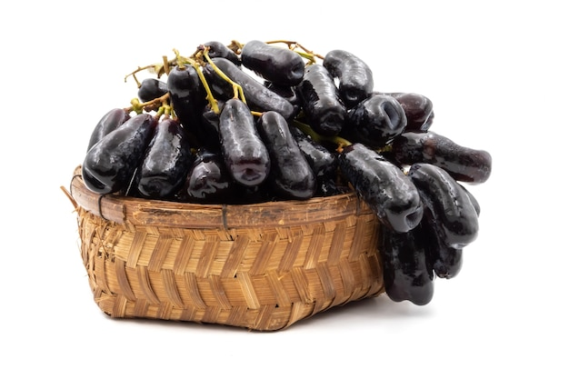 Black seedless moon drops grape or witch fingers grape in basket on white background