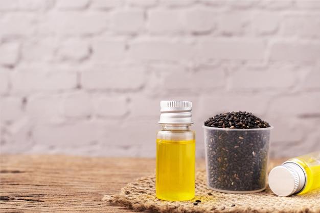 Black sesame oil on wooden table.