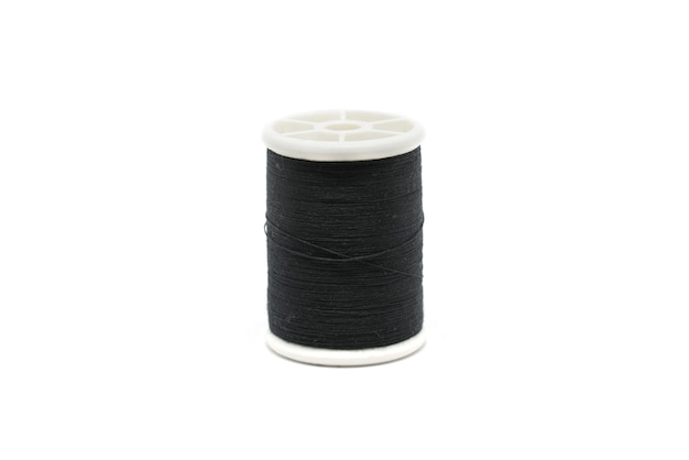 Black sewing thread isolated on white background.