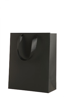 Black shopping bag isolated on white .