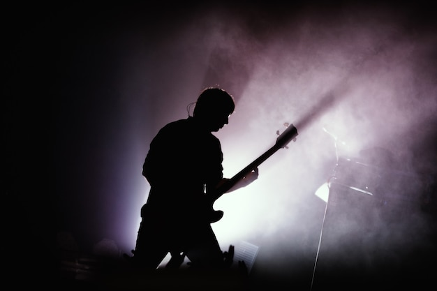 Black silhouette of guitarist at rock concert