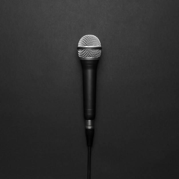 Black and silver microphone on a black background