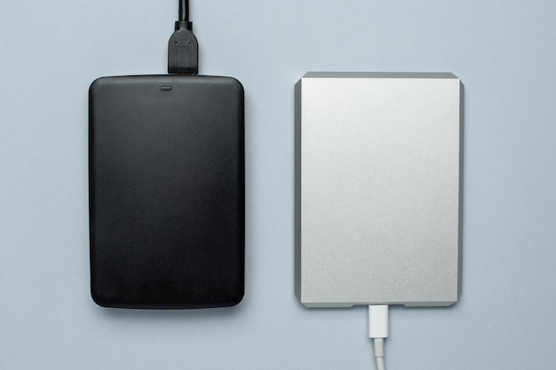 Black and silver removable hard drives on gray