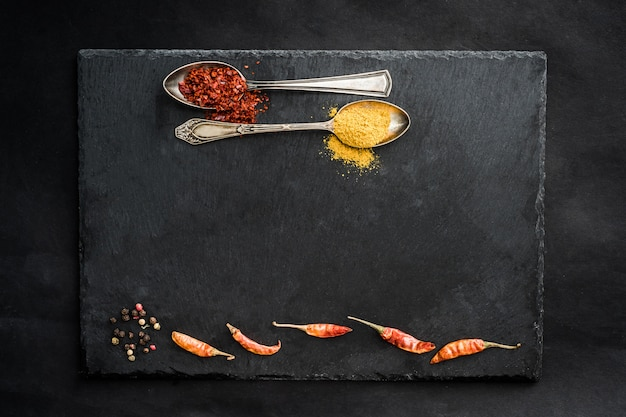 Black slate board with spices