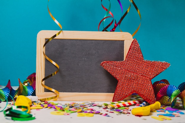 Black slate with streamers and a red star