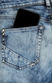 Black smartphone in jeans back pocket