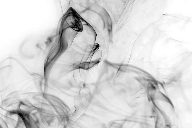 Black smoke on a white background.