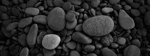 Черная гладкая круглая галька фон Premium Фотографии