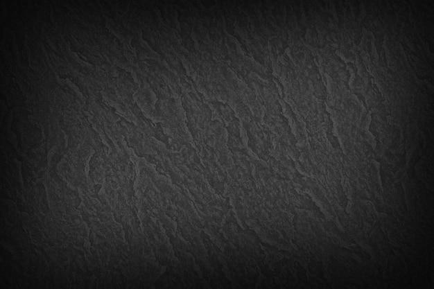 黒の滑らかなテクスチャ紙の背景
