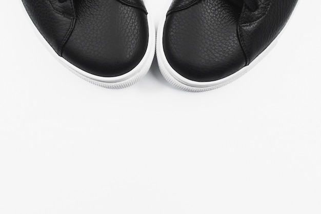 Black sneakers. flat lay, top view minimal background.