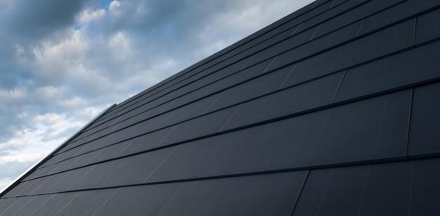 검은 태양 지붕 개념입니다. 현대식 단결정 검은색 태양광 지붕 타일로 구성된 건물 통합형 태양광 발전 시스템. 3d 렌더링.