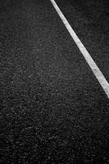 Black solid asphalt with a white stripe