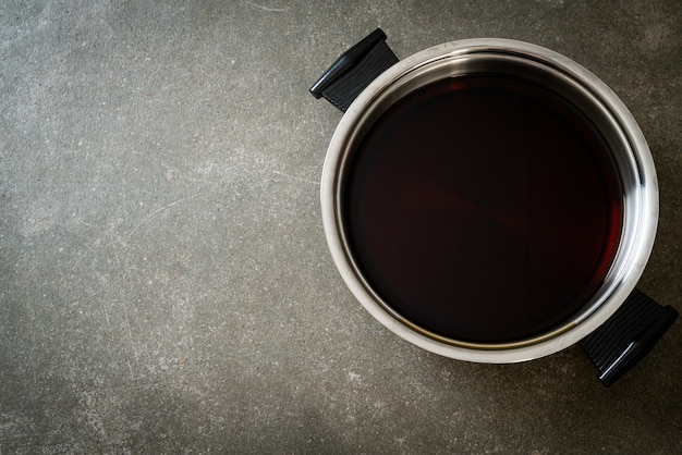 Black soup in hot pot for shabu or sukiyaki - japanese food style