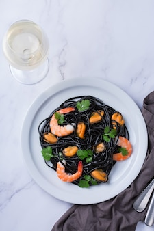 Black spaghetti pasta with seafood shrimps mussels and parsley
