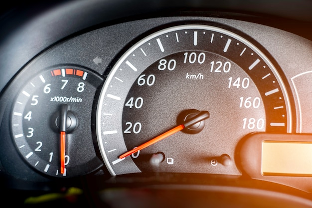 Black speedometer and other gauges in the car.