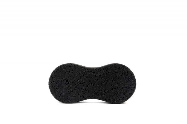 Black sponge for cleaning and washing close up, isolated on white scene.