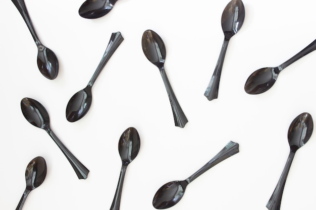 Black spoons on white
