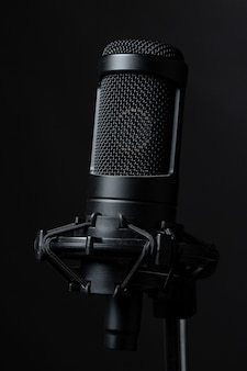 Black standing microphone in studio