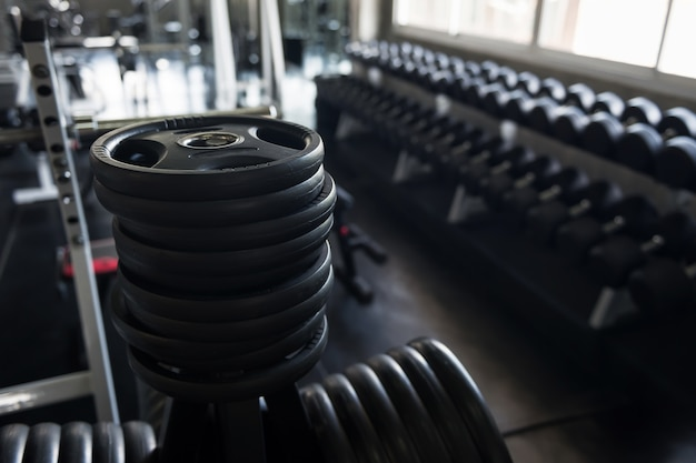 Black steel burbell disks in gym