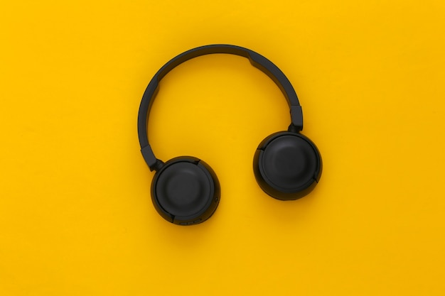 Black stereo headphones on yellow