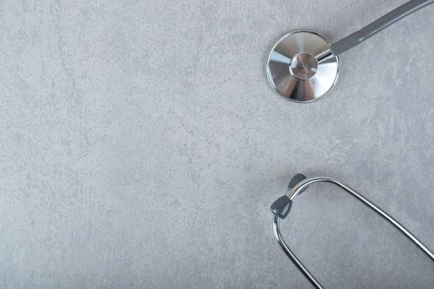 Black stethoscope isolated on gray surface