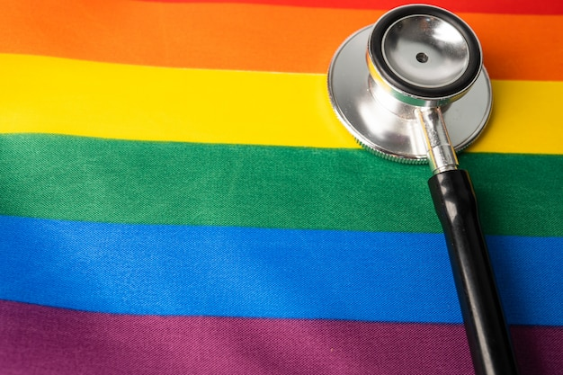 Black stethoscope on rainbow, symbol of lgbt pride month.