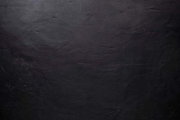 Черный каменный фон с царапинами и вмятинами