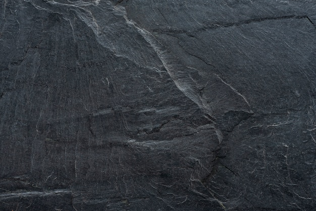 Black stone cladding texture contain crack and stone lines suitable for wall or surface