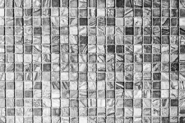 黒い石のタイル壁のテクスチャ