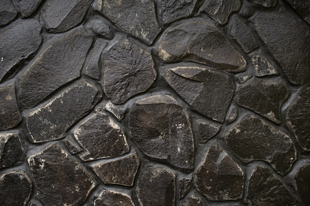 Black stone wall texture. bali. indonesia