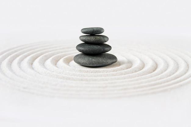 Black stones pile in the sand. zen japanese garden background scene