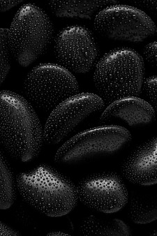 Black stones.rock background and water drop