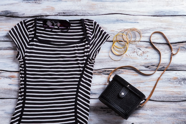 Black striped dress and sunglasses. classic handbag with casual dress. girl's dark spring outfit. discounts for new clothing.