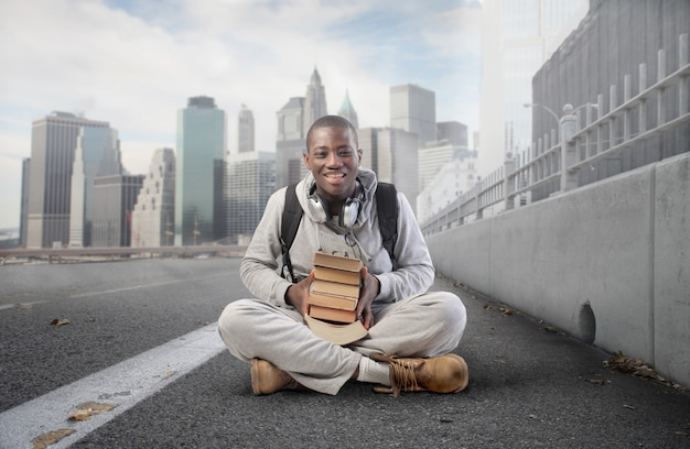 Black student guy with books