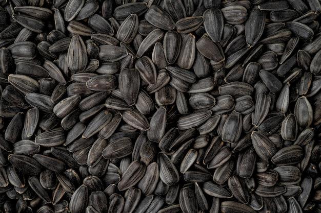 黒のヒマワリの種の背景