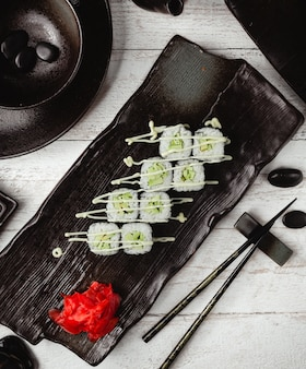 Black sushi with cucumber and mayonnaise