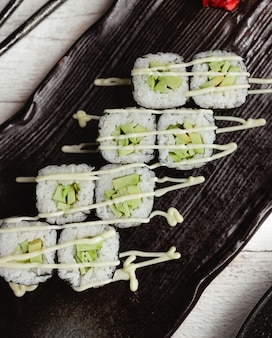 Black sushi with cucumber top view