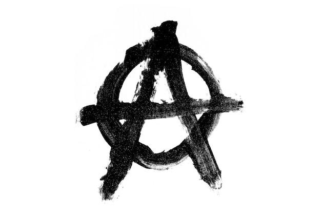 アナーキーの黒いシンボルは、白い背景に対して分離されています。高品質の写真