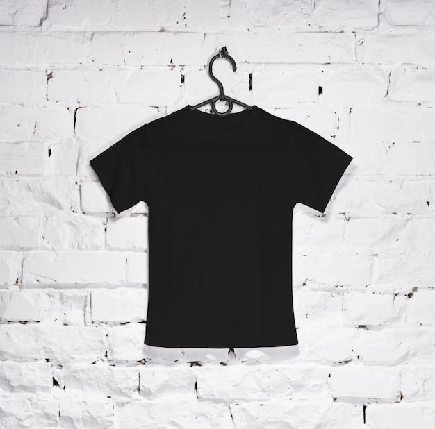 Black t-shirt for kids on hanger