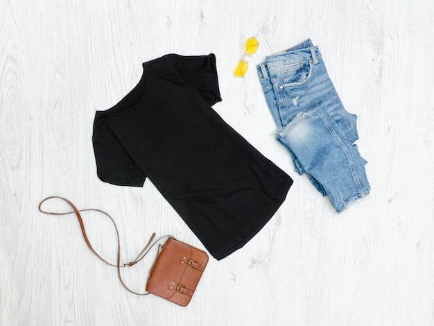 Black t-shirt, ripped jeans, handbag and sunglasses. fashionable concept