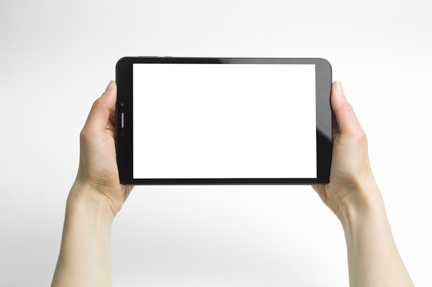 Black tablet in woman's hands isolated on white in horizontal mode