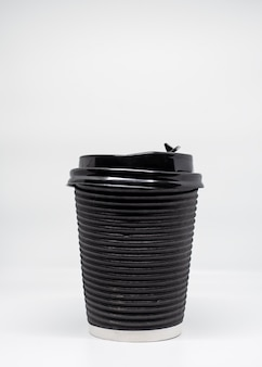 Black take away coffee cup on white background